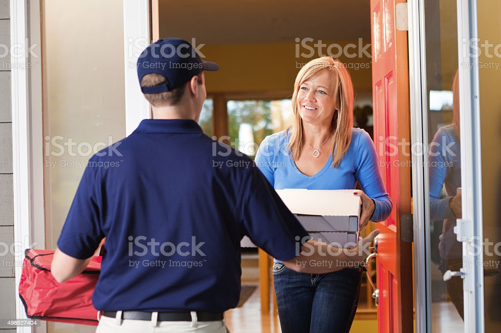 Take-out Pizza Delivery Man at Customer's Door stock photo