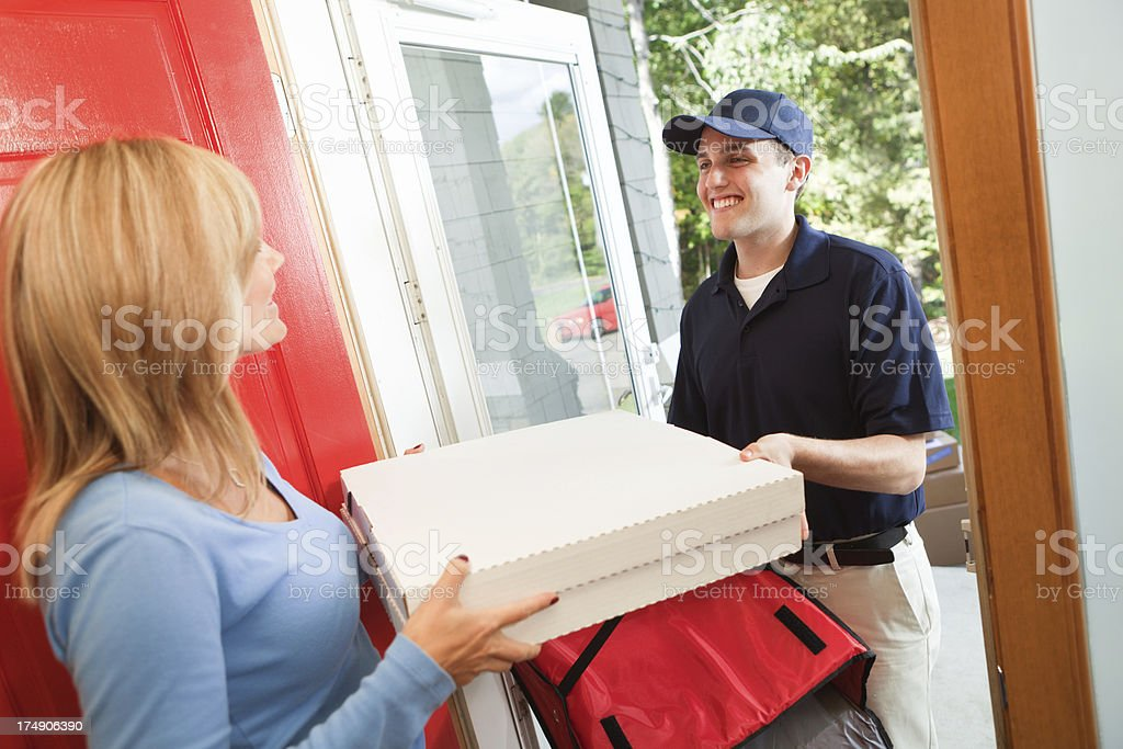Take-out Pizza Delivery Service Arriving at Customer's Door Hz stock photo