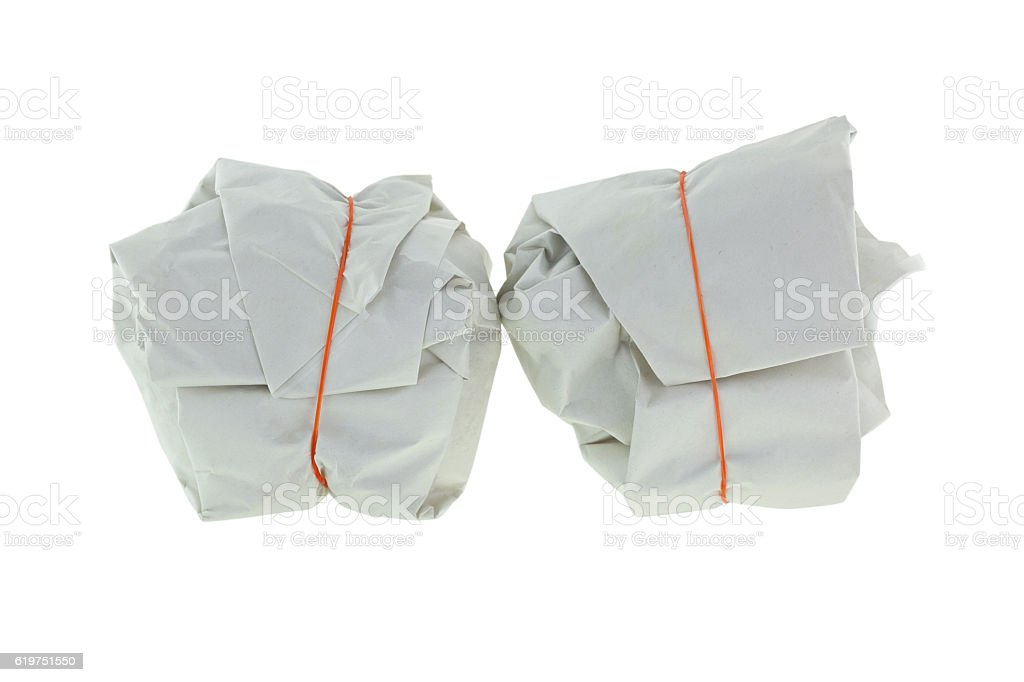 Takeout Thai Food wrapped in paper package with rubber band stock photo