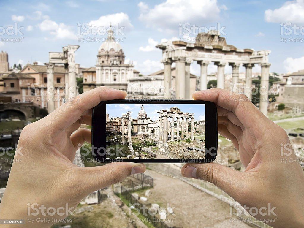 takes a picture of foro roman stock photo