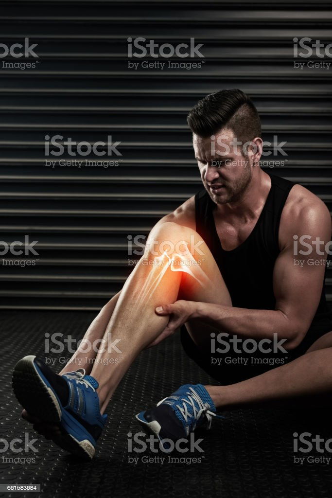 Takin extra care with his injured knee stock photo