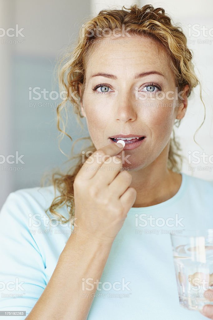 Taking a boost for her health - Vitamins & Supplements stock photo
