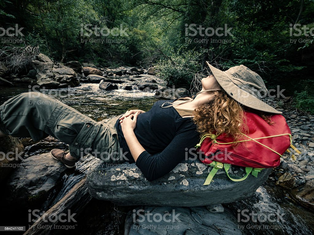 Taking a break in river creek during a trekking route stock photo