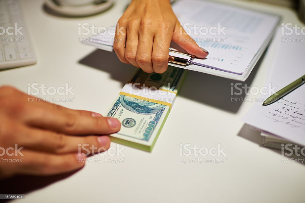 Taking a bribe stock photo