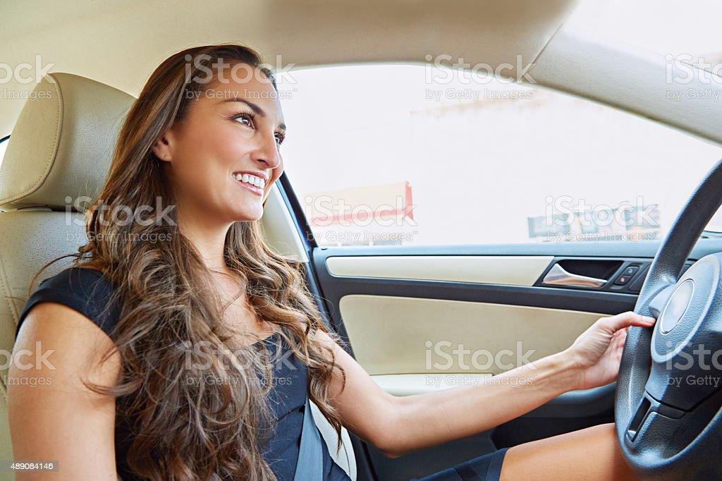 Taking a drive in her new ride stock photo