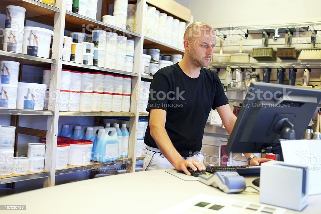 Taking a look at his store's webpage royalty-free stock photo