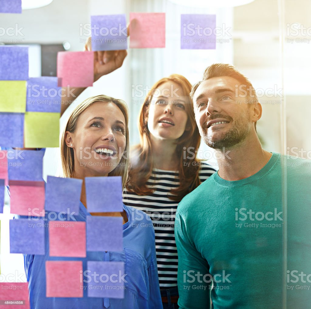 Taking a look at the wall of ideas stock photo