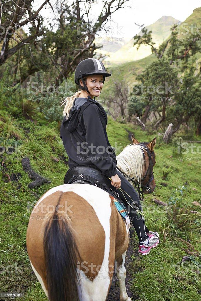 Taking a mountain horse ride stock photo