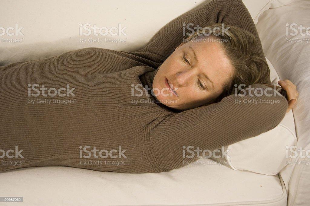 Taking a nap on sofa stock photo