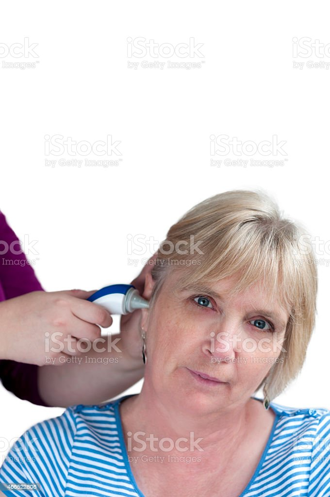 Taking A Patients Temperature Aurally stock photo