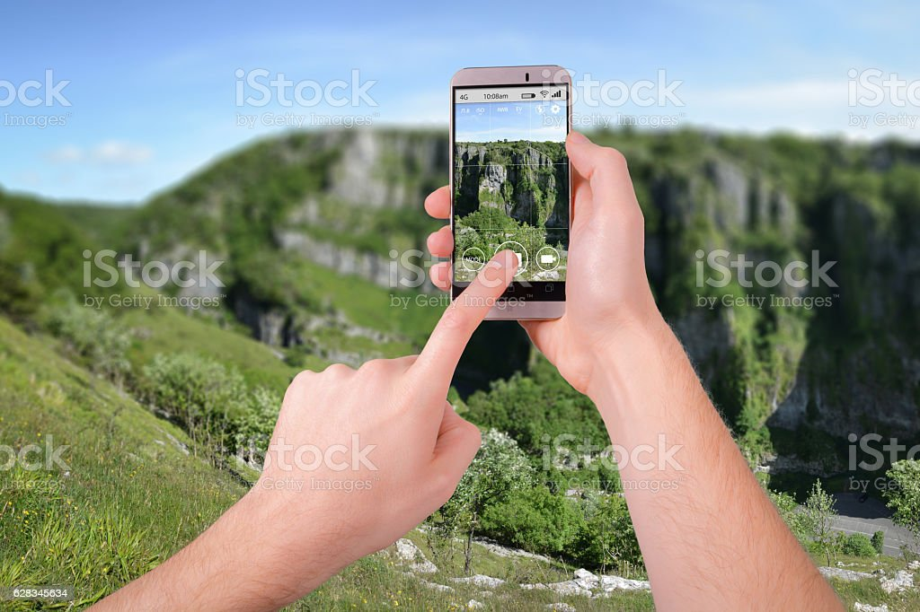 Taking a photo of Cheddar Gorge with a smartphone stock photo
