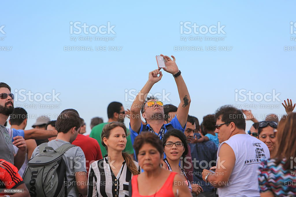 Taking a photo of Christ The Redeemer at Corcovado stock photo