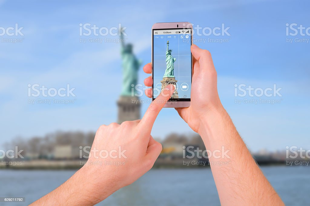 Taking a photo of New York with a smartphone stock photo