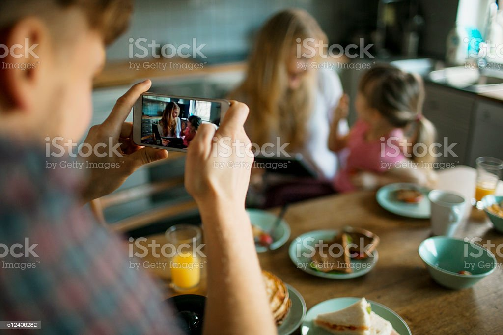 Taking a photo while having breakfast royalty-free stock photo
