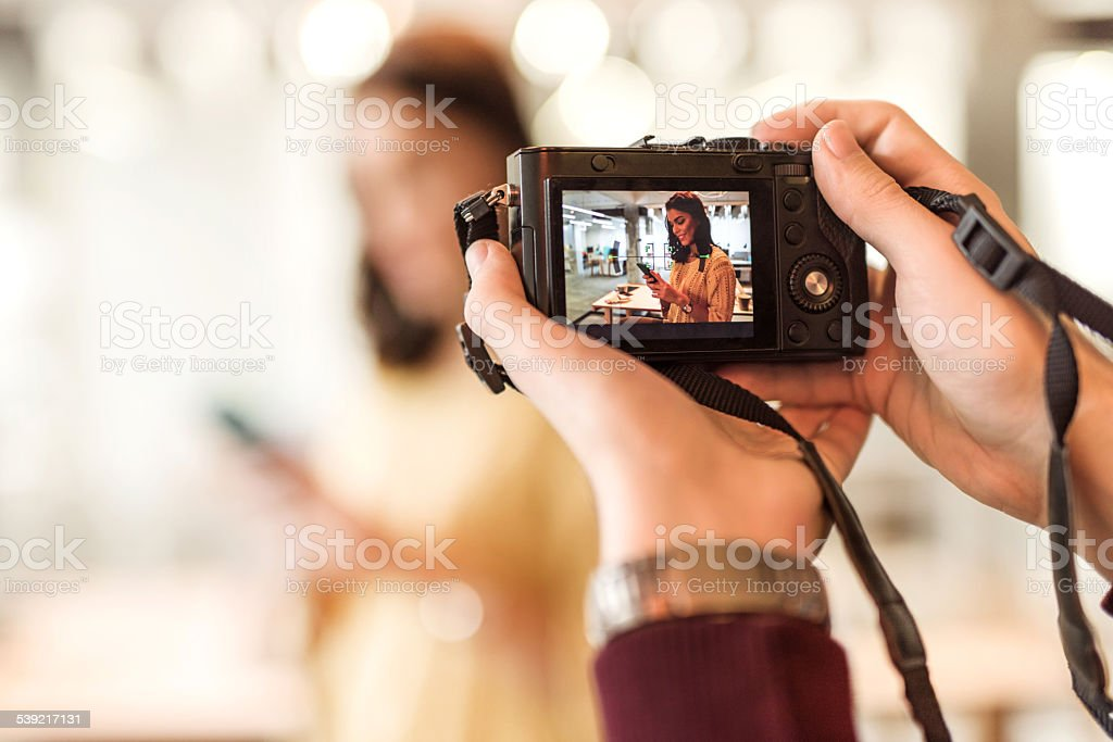 Taking a photo with digital camera. stock photo