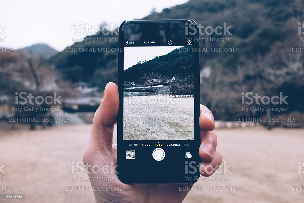 taking a photo with iphone 6 stock photo