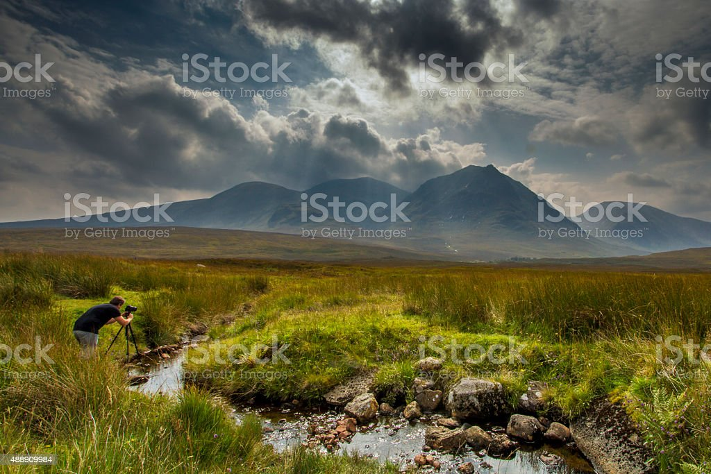 Taking a photograph of Scottish highlands stock photo