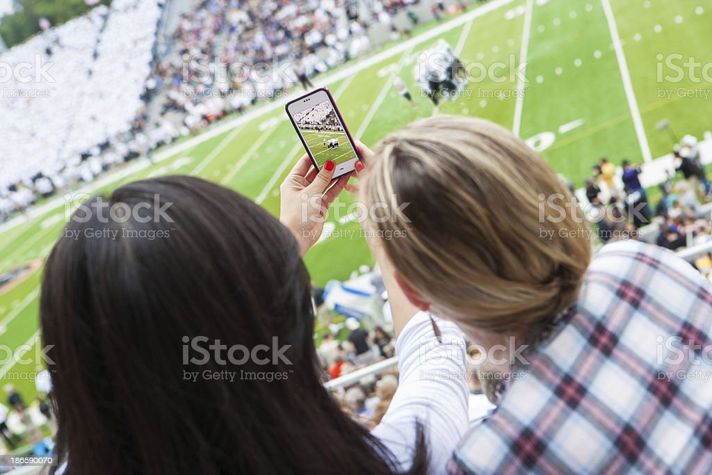 Taking a picture at sporting event royalty-free stock photo