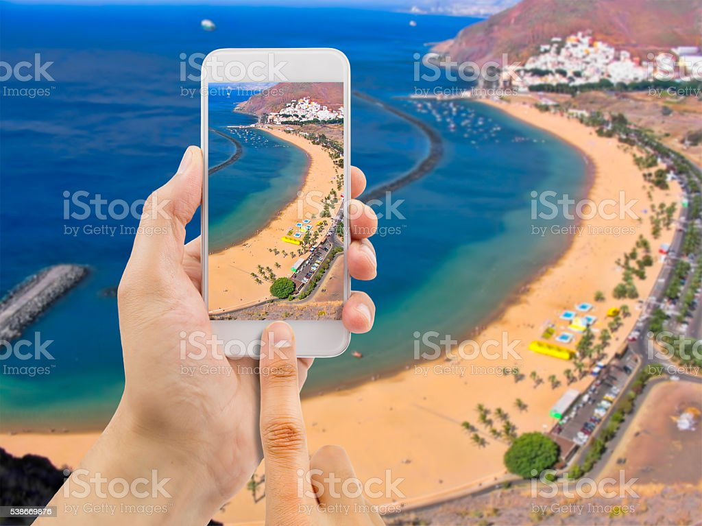 taking a picture at the beach of teresitas stock photo