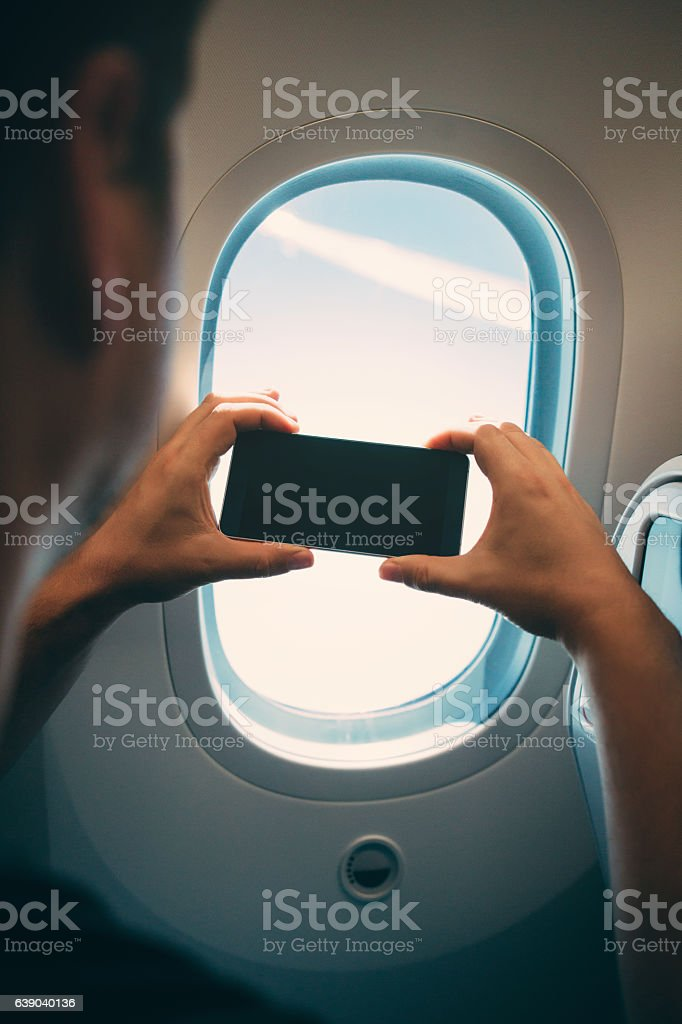 Taking a picture in an airplane stock photo
