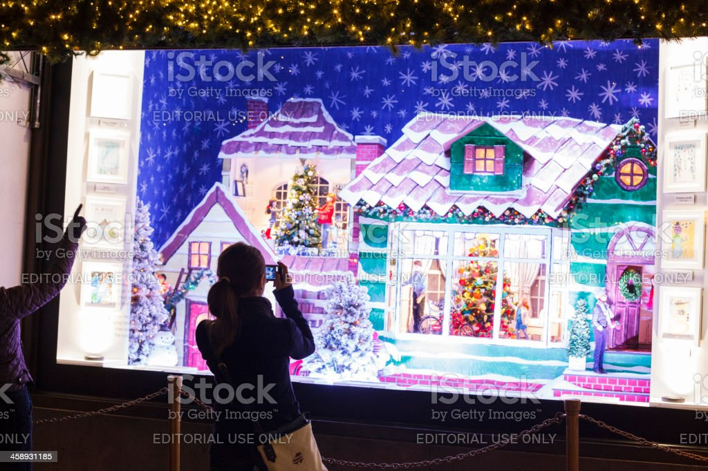 Taking a Picture Lord and Taylor Christmas Window royalty-free stock photo