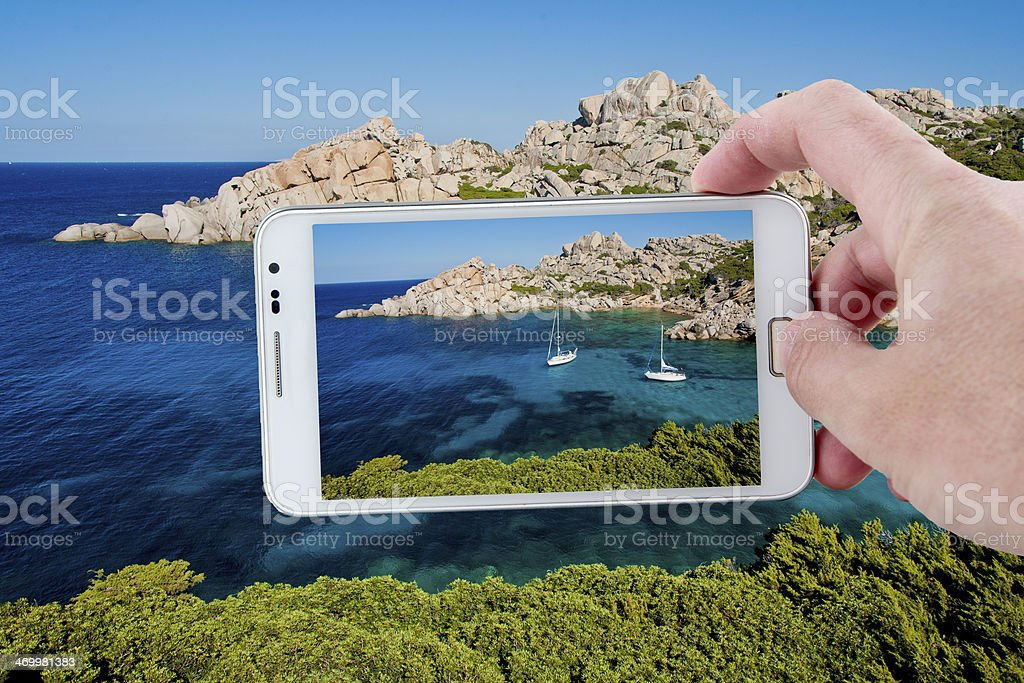 Taking a picture with Smartphone in Sardinia stock photo