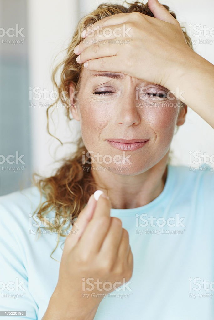 Taking a pill for the unbearable pain! royalty-free stock photo