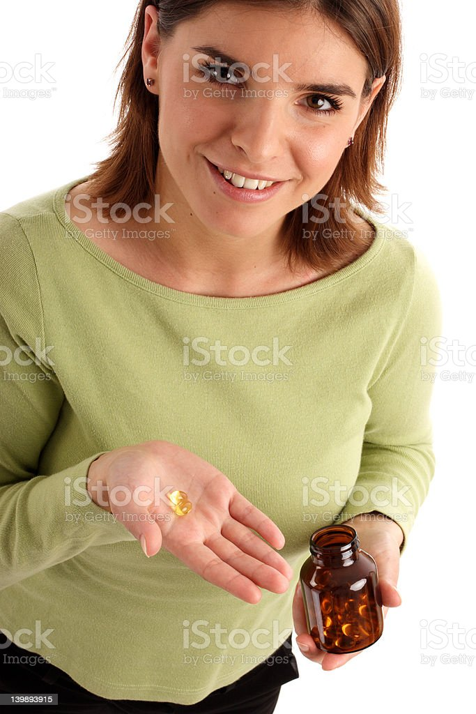 Taking a pill stock photo