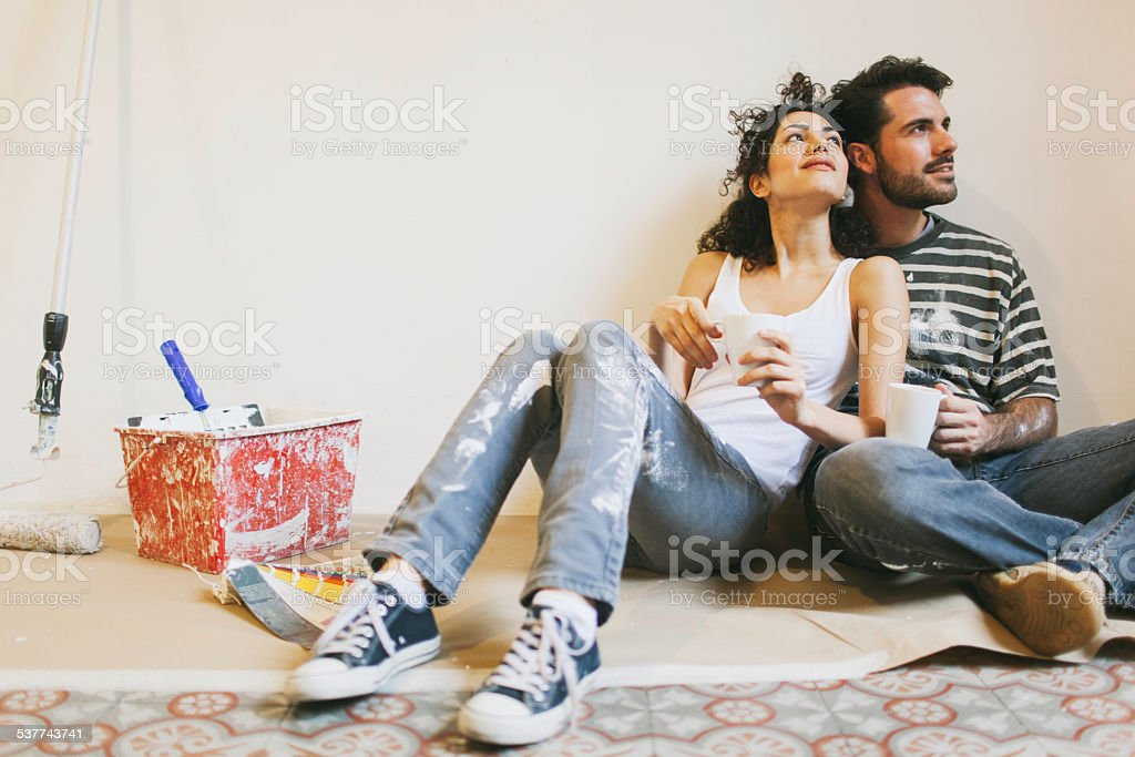 Taking a rest after painting apartment. stock photo