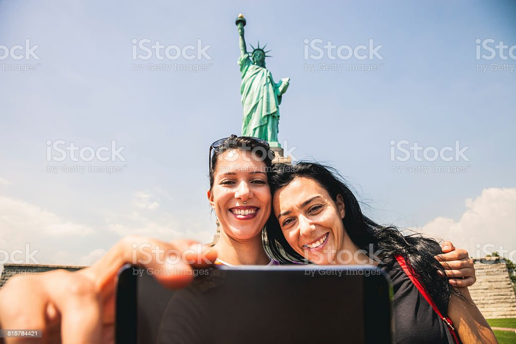 Taking a selfie in front of Statue of Liberty stock photo
