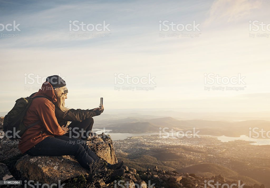 Taking  a selfie on top of the world stock photo