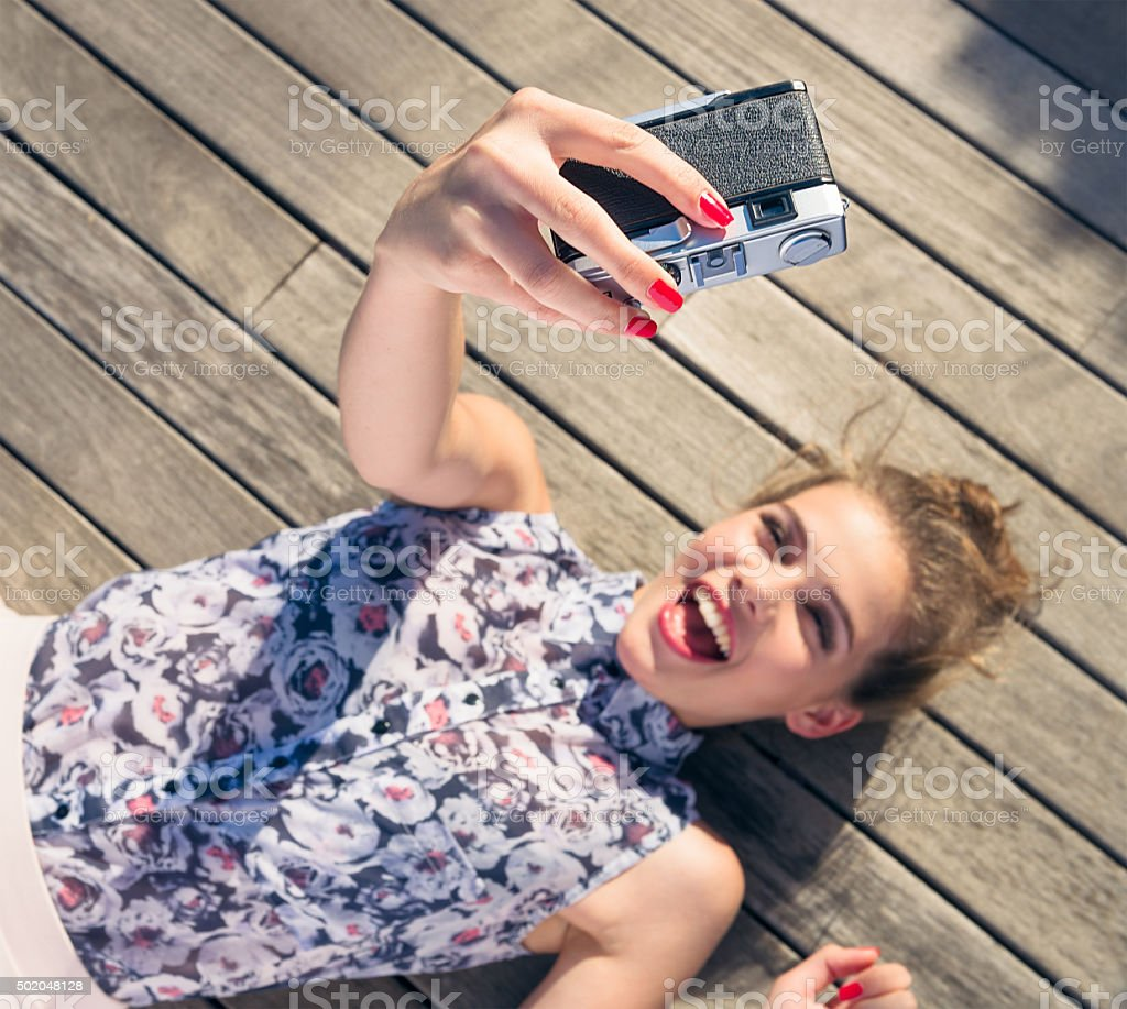 Taking a selfie with a vintage film camera stock photo