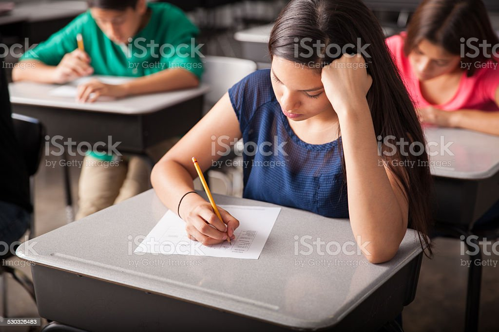 Taking a test in high school stock photo