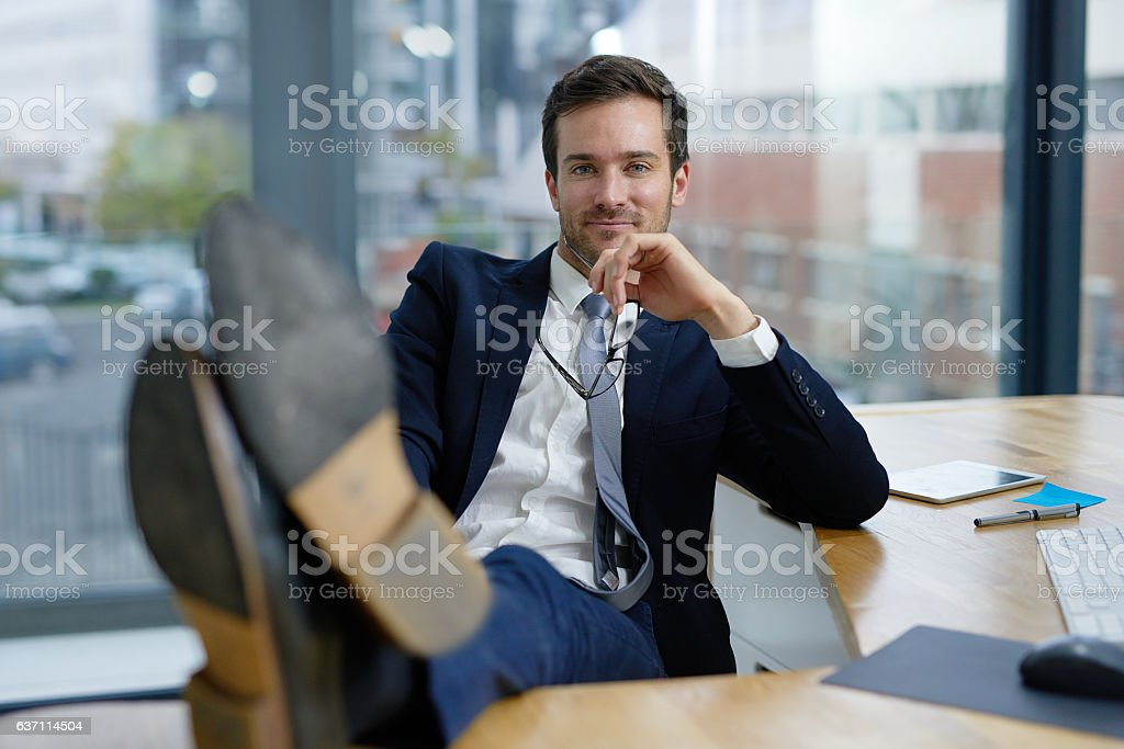 Taking a time out from his busy business day stock photo