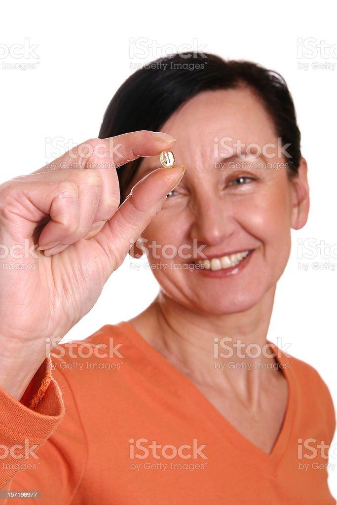 Taking a vitamin royalty-free stock photo