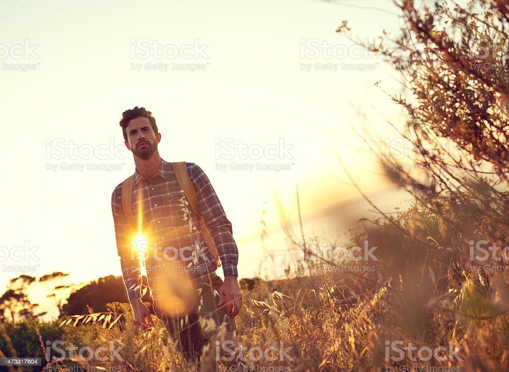 Taking a walk in the sun stock photo
