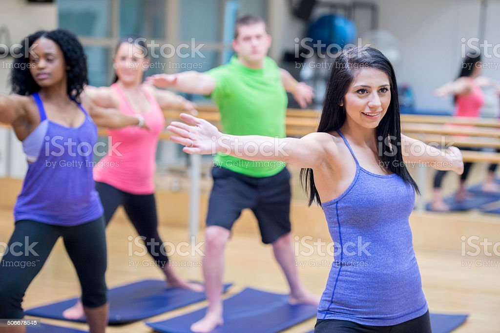 Taking a Yoga Class at the Gym stock photo