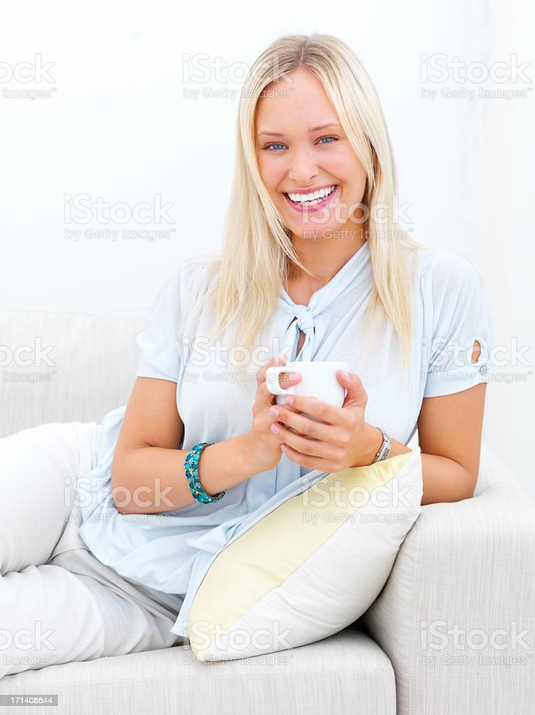 Taking advantage of her comfortable couch royalty-free stock photo