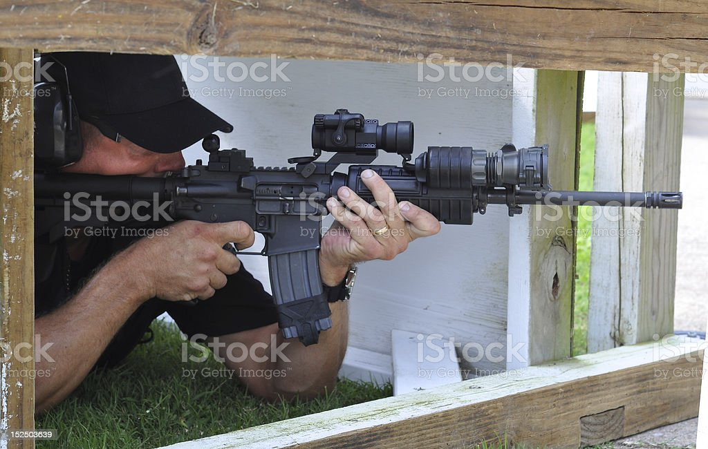 Taking Aim From Cover stock photo