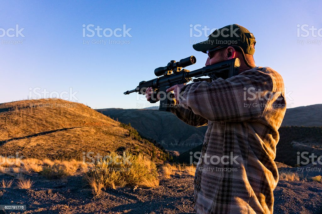 Taking Aim with Assault Rifle Weapon stock photo