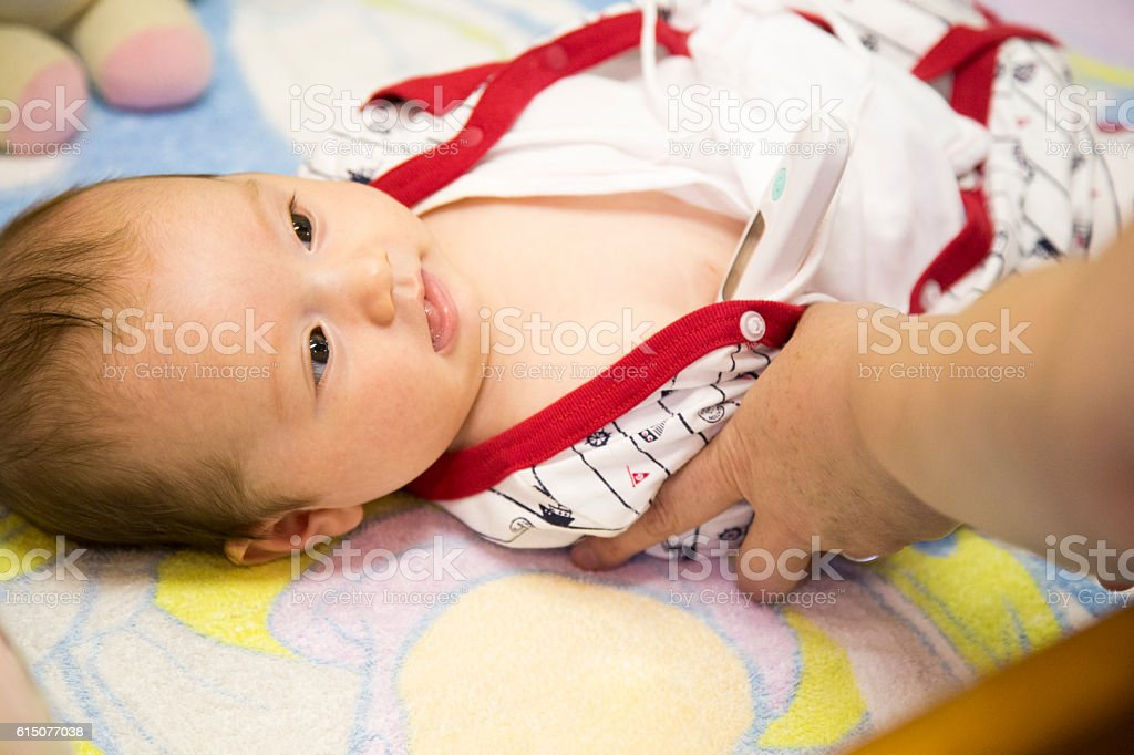 Taking Baby's Temperature stock photo