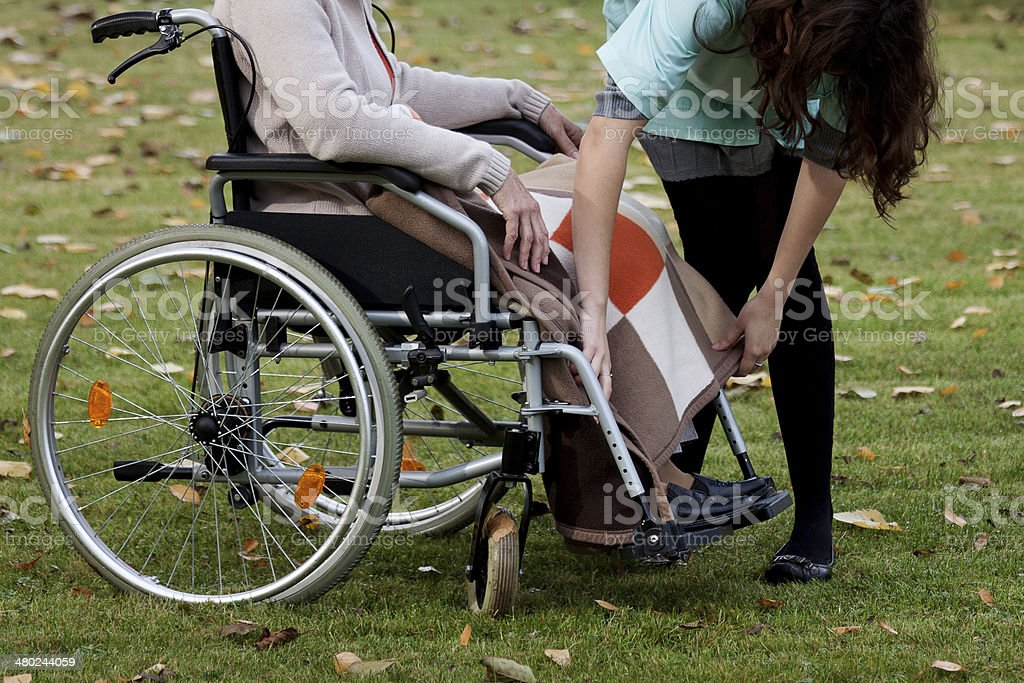 Taking care of elderly woman royalty-free stock photo