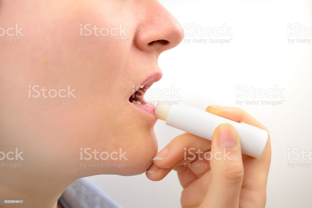taking care of her lips stock photo