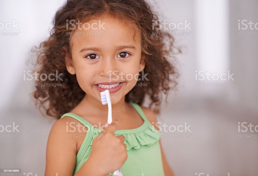 Taking care of her teeth from a young age stock photo