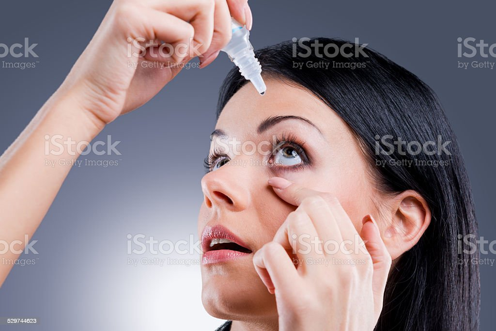 Taking care of her vision. stock photo