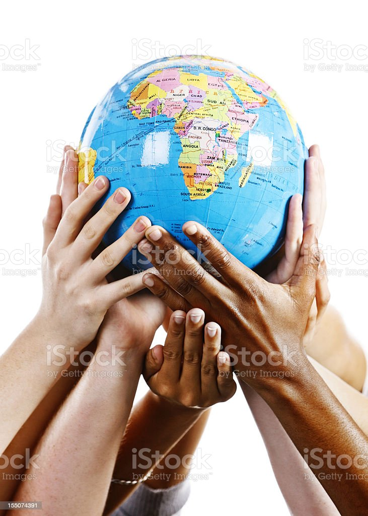 Taking care of our world; many hands support geographical globe stock photo