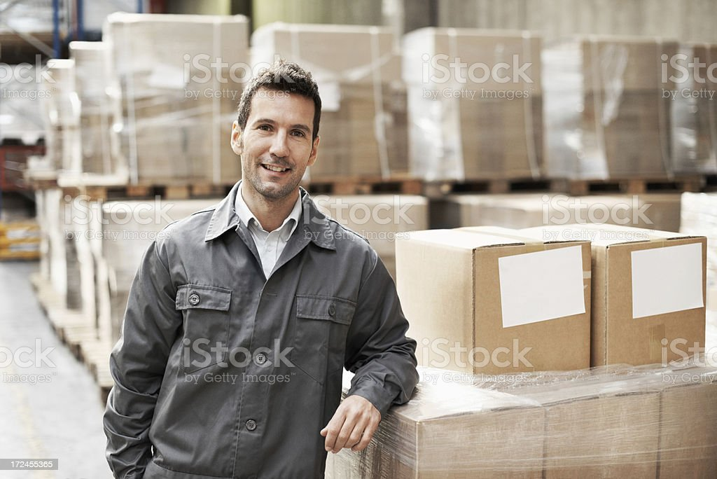 Taking care of warehouse management with a smile royalty-free stock photo
