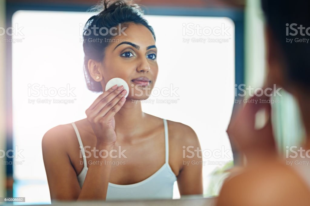 Taking care to prevent clogged pores and bumpy skin stock photo