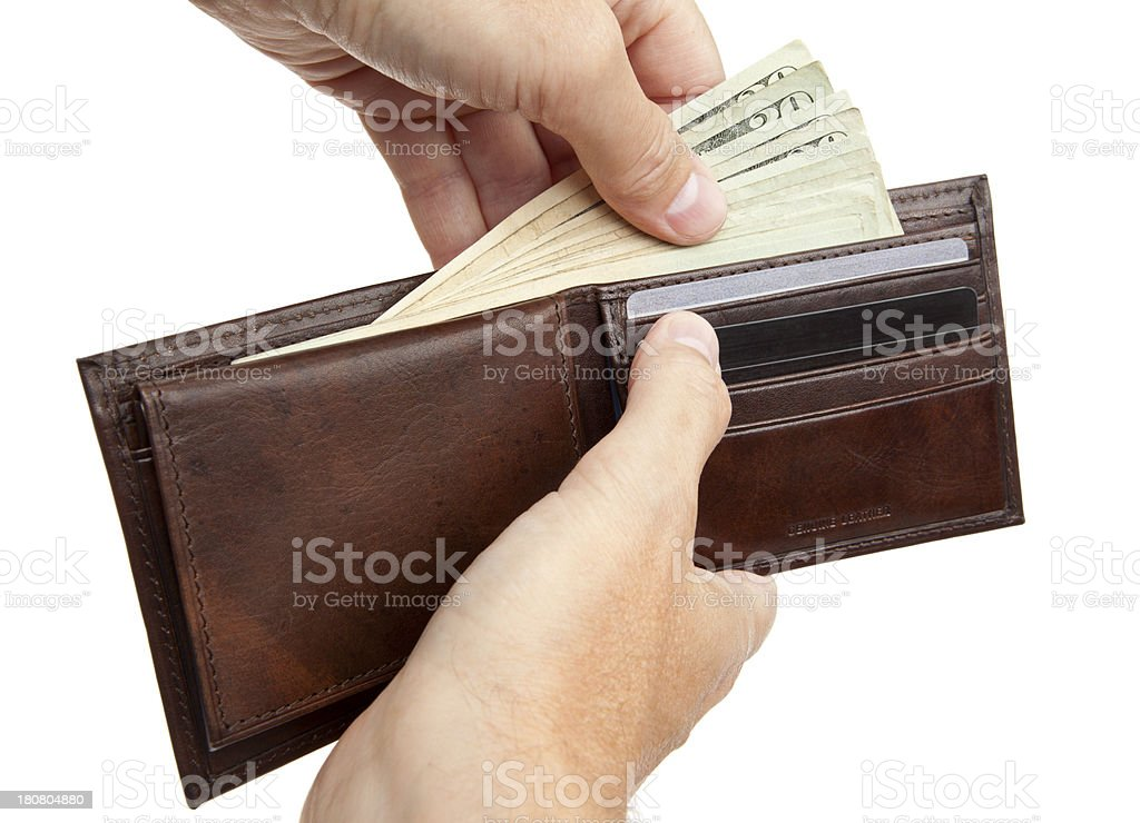 Taking Cash From a Wallet stock photo