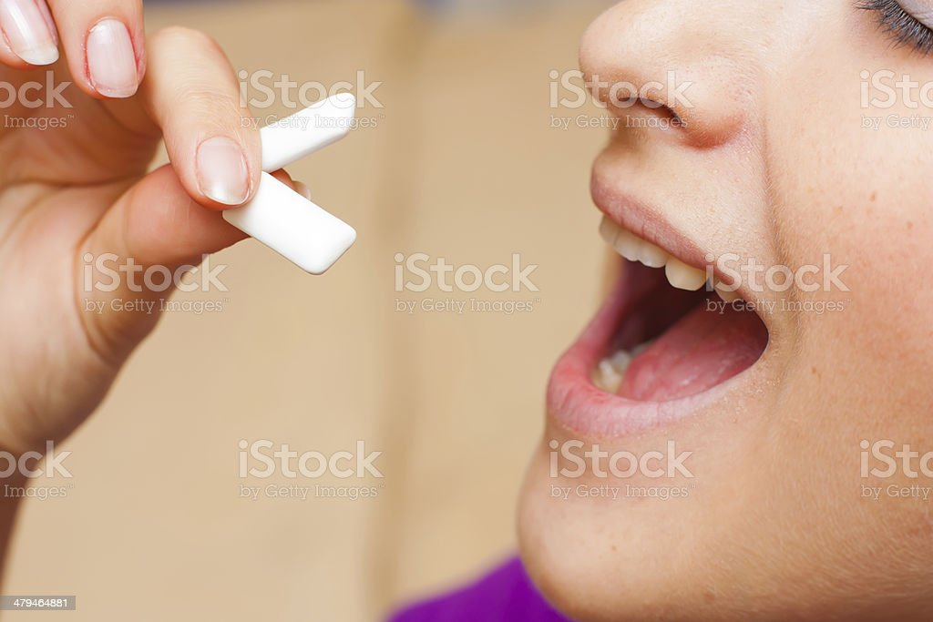 Taking chewing gums stock photo